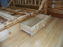 Custom rustic log bed with drawers and log trim by Adirondack LogWorks