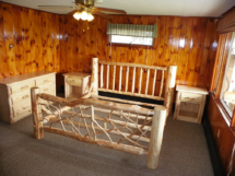 Custom rustic log bed with twig woodwork, log dresser, and log night stands by Adirondack LogWorks