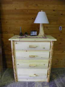 Custom rustic log dresser with log trim and log lamp by Adirondack LogWorks