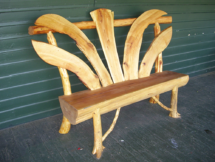Custom rustic log bench by Adirondack LogWorks