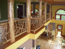 Custom rustic log posts and twig loft railings by Adirondack LogWorks