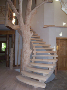 Custom rustic log spiral stairs and log tree by Adirondack LogWorks