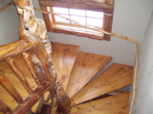 Custom rustic log stairs, log trim, and log handrail by Adirondack LogWorks