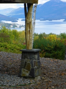 Custom rustic log support posts by Adirondack LogWorks