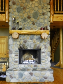 Custom rustic log mantel by Adirondack LogWorks