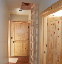 Custom rustic log trim woodwork and log ladder by Adirondack LogWorks