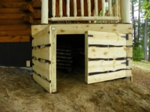 Custom rustic log siding and log gate by Adirondack LogWorks
