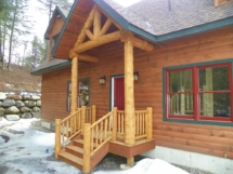 Custom rustic log truss and entryway woodwork by Adirondack LogWorks