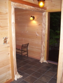 Custom rustic log flair-based entryway woodwork by Adirondack LogWorks