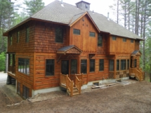 Custom log home entryway truss woodwork at Ski Bowl Village in North Creek, N.Y., by Adirondack LogWorks