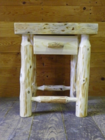 Custom-made rustic log bed stand with drawer and live edge by Adirondack LogWorks