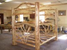 Custom rustic log canopy bed by Adirondack LogWorks