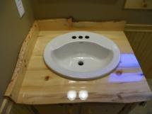 Custom rustic live-edge log vanity sink counter top by Adirondack LogWorks