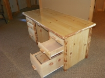 Rustic log desk with drawers and live-edge log trim by Adirondack LogWorks