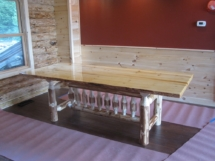 Custom rustic log dining room table with live-edge slab top by Adirondack LogWorks
