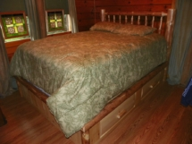 Custom rustic log king-sized bed with drawers and log trim by Adirondack LogWorks