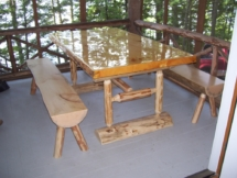 Custom rustic log picnic table by Adirondack LogWorks