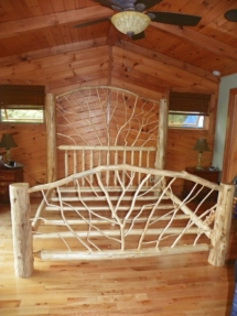 Custom-made rustic log bed with twig woodwork by Adirondack LogWorks