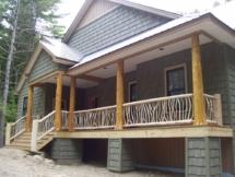 Custom-made vertical twig log railings by Adirondack LogWorks