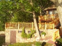 Custom rustic log railings and post woodwork by Adirondack LogWorks