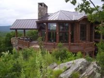 Custom rustic log railing and post woodwork by Adirondack LogWorks