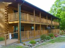 Custom rustic log railings and log handrails at a log home by Adirondack LogWorks