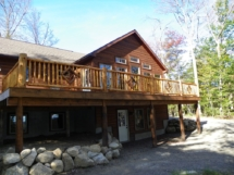 Custom rustic log railings with diamond twig woodwork by Adirondack LogWorks