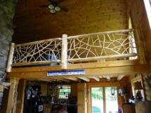 Custom rustic log loft railings with twig woodwork by Adirondack LogWorks