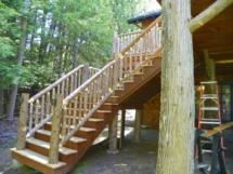 Custom rustic bark-on log railing woodwork by Adirondack LogWorks