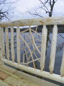 Custom rustic log railing with twig woodwork by Adirondack LogWorks
