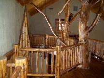 Custom rustic log railings at a log home by Adirondack LogWorks