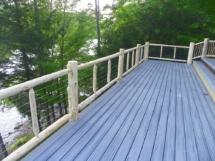Custom rustic log railings with wire rail by Adirondack LogWorks