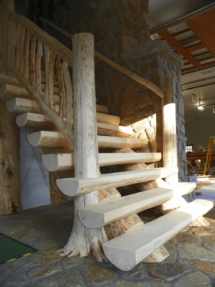 Custom rustic flair-based log stairs and railings by Adirondack LogWorks
