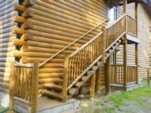 Custom log stair, railing, and post rustic woodwork by Adirondack LogWorks