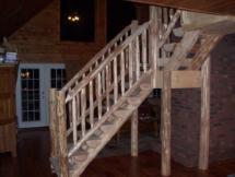 Custom log stair and railing rustic woodwork by Adirondack LogWorks