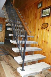 Custom rustic live-edge log stairs by Adirondack LogWorks