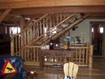 Custom rustic log stairs and railings by Adirondack LogWorks