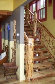 Custom rustic twig railing and log stair woodwork by Adirondack LogWorks