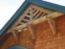 Custom rustic bark-on log trussing by Adirondack LogWorks