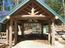 Custom bark-on rustic log truss woodwork by Adirondack LogWorks