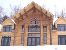 Custom rustic log home truss woodwork by Adirondack LogWorks